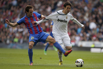 Real Madrid's Kaka challenges Levante's Herrero during their Spanish first division soccer match at Santiago Bernabeu stadium in Madrid