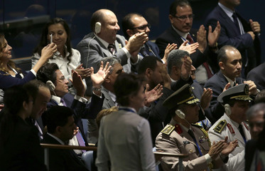 People in the audience applaud Egypt's President Abdel Fattah al-Sisi as he takes the stage before his address to the 69th United Nations General Assembly at U.N. headquarters in New York