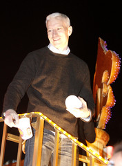 Grand Marshal Anderson Cooper celebrates during the Krewe of Endymion parade down St. Charles Avenue in New Orleans