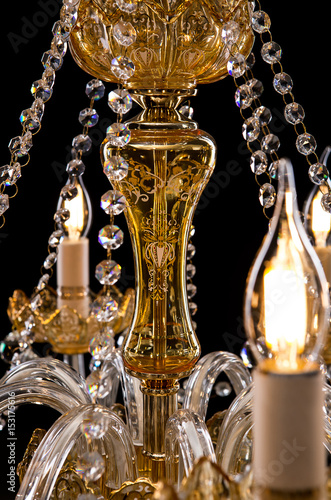 Contemporary Gold Chandelier Isolated On Black Background Close Up Crystal