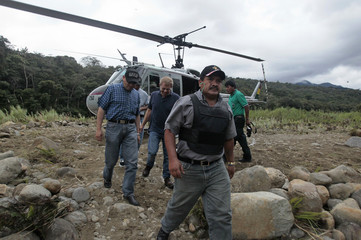 Bolivian Vice Minister of Social Defense Caceres, Bolivia's Presidency Minister Romero and U.S. representative McHugh arrive at Pampa Colorada in the Carrasco National Park