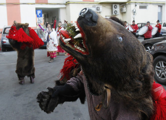 "A dancer from Romania's northern region of Moldova performs ""bear"" dance, a ritual for good luck in the New Year, in Bucharest"