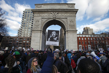 A picture of Martin Luther King Jr is seen on a placard at Washington Square during a march against police violence, in New York