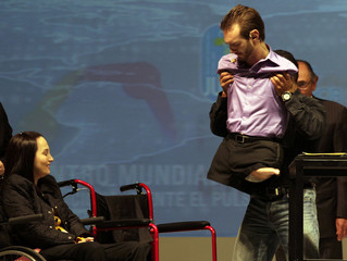 Vujicic, a motivational speaker born without limbs, is helped onto his wheelchair after giving a conference as part of the Fourth World Meeting of Human Values in Monterrey