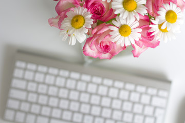 Woman office desk with blossom flowers