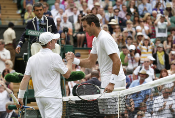 Juan Martin del Potro of Argentina shakes hands with Jesse Levine of Canada after defeating him in their men's singles tennis match at the Wimbledon Tennis Championships, in London