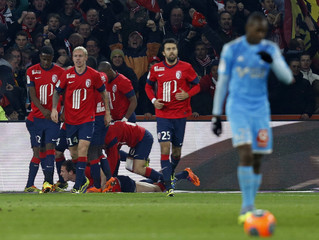 Lille's Roux celebrates with team mates after scoring against Olympique Marseille during their French Ligue 1 soccer match at the Pierre Mauroy Stadium in Villeneuve d'Ascq