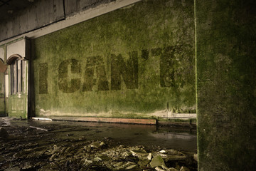 text i cant on the dirty wall in an abandoned ruined house