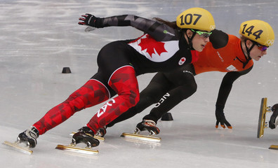 Canada's Maltais in action to set an Olympic record as she skates near Yara van Kerkhof of Netherlands in the women's 1,000 metres short track speed skating heat event at the Iceberg Skating Palace during the 2014 Sochi Winter Olympics