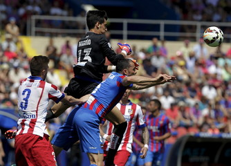 Levante's goalkeeper Marino punches the ball during their Spanish first division soccer match against Atletico Madrid at the Ciudad de Valencia stadium in Valencia