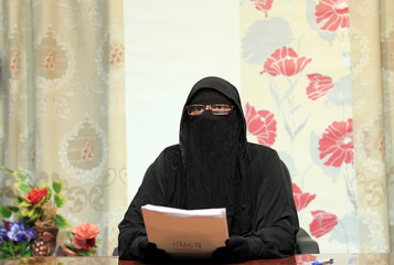 A presenter looks on in a studio of a new TV channel which is being managed and run exclusively by women who wear the full veil, to be launched this weekend, in Cairo