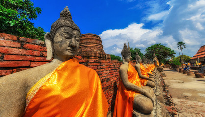 Aligned buddha statues at Wat Yai Chaimongkol Ayutthaya, Bangkok, Thailand