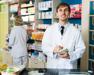 Technician working in chemist shop