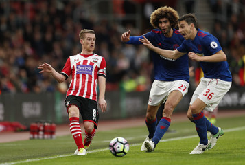 Southampton's Steven Davis in action with Manchester United's Marouane Fellaini and Matteo Darmian
