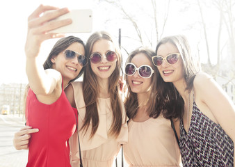 Smiling girls doing a selfie