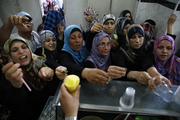 Palestinians crowd into an ice cream shop in Gaza City