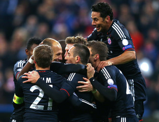 Munich players celebrate after scoring against Lille during their Champions League Group F soccer match in Munich
