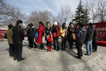Participants take part in a matchmaking event to look for potential partners at Ditan Park in Beijing