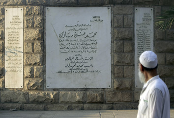 A man walks past a sign outside the Mosque of Mohamed Ali Pasha, situated on the summit of the ancient citadel of Salah Addin Alayoubi, after Eid al-Fitr prayer, in old Cairo