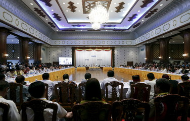 Myanmar's President Thein Sein speaks at a meeting of the political parties following last week's election in Yangon, Myanmar