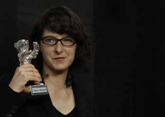 French-Swiss film director Ursula Meier gives a speech after she received the Honourable Mention award during the awards ceremony at the 62nd Berlinale International Film Festival in Berlin