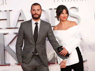 Jamie Dornan and his wife Amelia Warner arrive at the UK premiere of Fity Shades Darker, in Leicester Square,  London