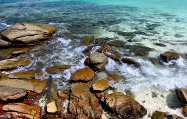 Rock in clear sea water.