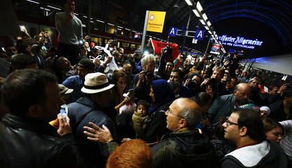 A family of migrants from Syria arrives at the railway station in Frankfurt