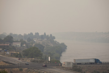 The town of Bridgeport, Washington, perched on the Columbia River, sits engulfed in smoke from the Carlton Complex Fire