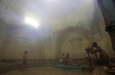 Men bathe inside a traditional Turkish bath in Samawa