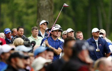 Watson of the U.S. watches his tee shot on the 15th hole during the first round of the Wells Fargo Championship PGA golf tournament in Charlotte
