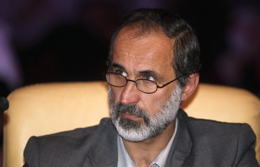 Activist preacher Mouaz al-Khatib attends the General Assembly of the Syrian National Council in Doha