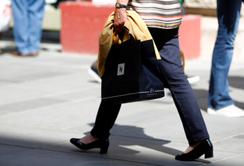 A women carries a shopping bag of Nespresso coffee in Vienna