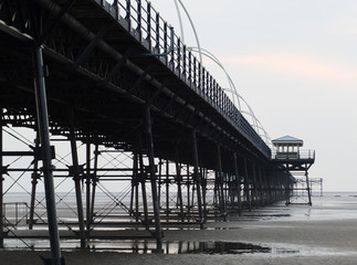 southport pier showing beach and structure in the evening