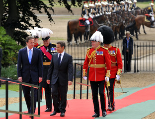 France's President Nicolas Sarkozy and British Prime Minister David Cameron arrive at the Royal Hospital Chelsea in London