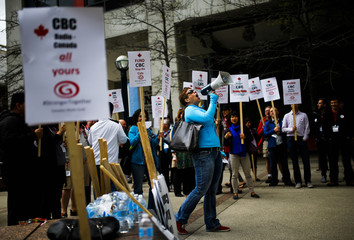 Canadian Broadcast Corporation employees protest funding cuts outside the CBC Broadcasting Centre in Toronto
