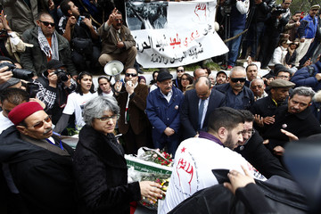 Basma, the widow of assassinated secular opposition leader Belaid, gathers with Belaid's other family members at his tomb to mark the 40th day of mourning after his death in Tunis