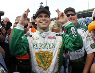 Carpenter of the U.S. waits for the last driver before celebrating taking the pole position for the Indianapolis 500
