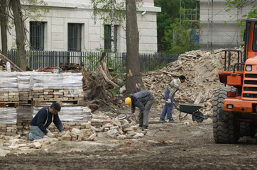 Men work at the construction site of a new Greek embassy building in Berlin