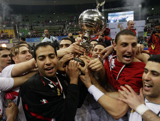 Tunisian players celebrate with the trophy after winning their final match against Egypt at the 19th Africa Nations Handball Championship in Cairo