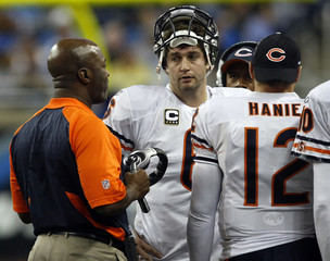 Chicago Bears head coach Smith talks to quarterback Cutler during the second half of their NFL football game against the Detroit Lions in Detroit