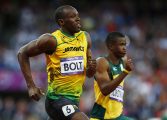 Jamaica's Usain Bolt runs next to South Africa's Anaso Jobodwana in their men's 200m semi-final during the London 2012 Olympic Games at the Olympic Stadium