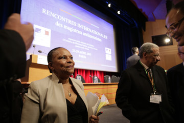 French Justice Minister Taubira leaves the podium after she delivered her opening remarks at the start of an international meeting of anti-terror magistrates in Paris