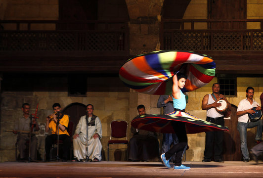 Youth practises dancing as a whirling dervish during a class at a performing arts theatre in Cairo