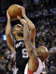 Spurs guard Tony Parker goes up for a shot against Raptors defender Anthony Carter during their NBA basketball game in Toronto