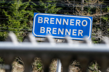 "A sign reading ""Brenner - Brennero"" is pictured at the train station on the Italian-Austrian borde"