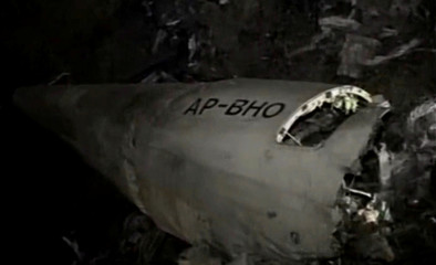 The wreckage of a plane is seen as Pakistani army and emergency services begin rescue operation at a remote crash site where a plane carrying 47 people crashed into a northern Pakistan mountain, in this still frame taken from video