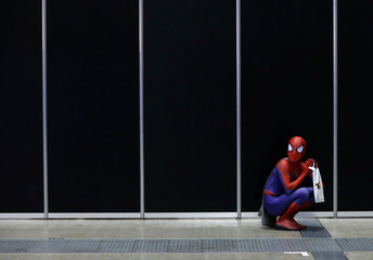 A man in a Spider-Man costume takes a rest at Tokyo Comic Con at Makuhari Messe in Chiba
