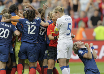 France's players celebrate defeating England after penalty shootout during their Women's World Cup quarterfinal soccer match in Leverkusen