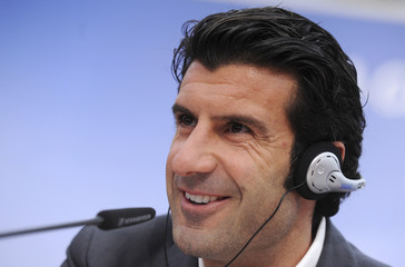 Portuguese soccer legend Luis Figo attends a news conference during UEFA Champions League Trophy Tour 2010 at the Milan Rastislav Stefanik square in Bratislava